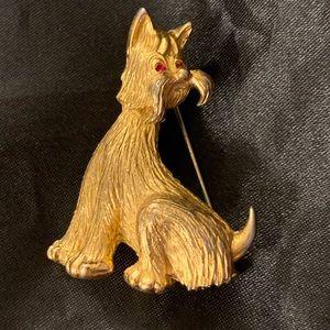 Golden dog figurine brooch